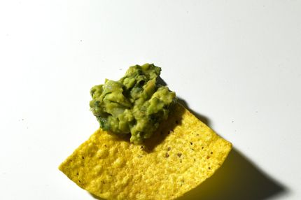 A tortilla chip with guacamole