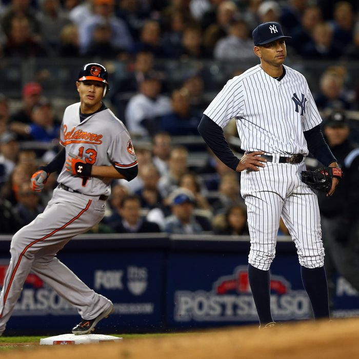 Alex Rodriguez #13 of the New York Yankees looks on as Manny Machado #13 of the Baltimore Orioles advances to third base on a double by Nate McLouth during Game Four of the American League Division Series at Yankee Stadium on October 11, 2012 in the Bronx borough of New York City.