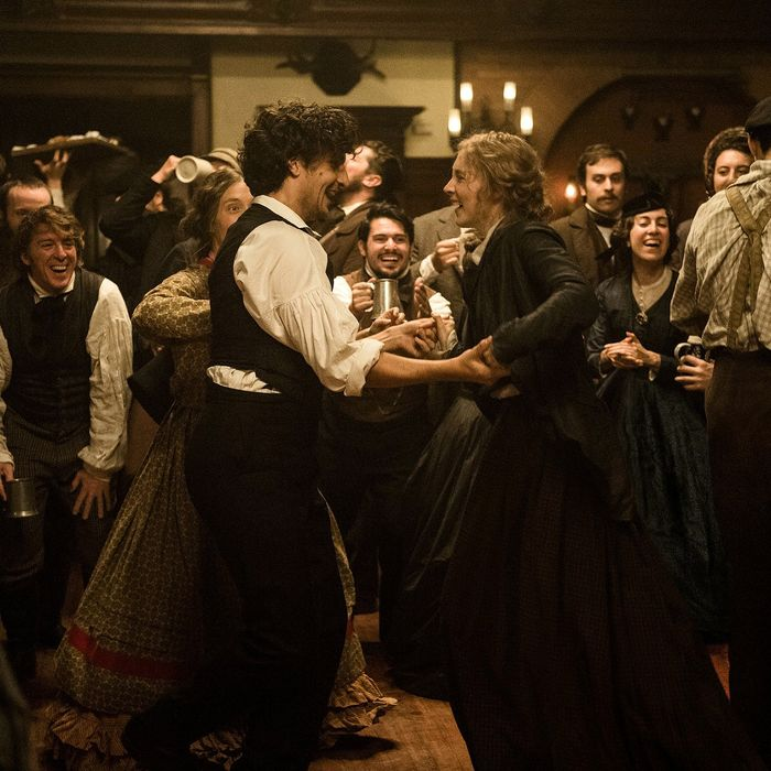 Louis Garrel (as Friedrich Bhaer) and Saoirse Ronan (as Jo March) in Little Women.