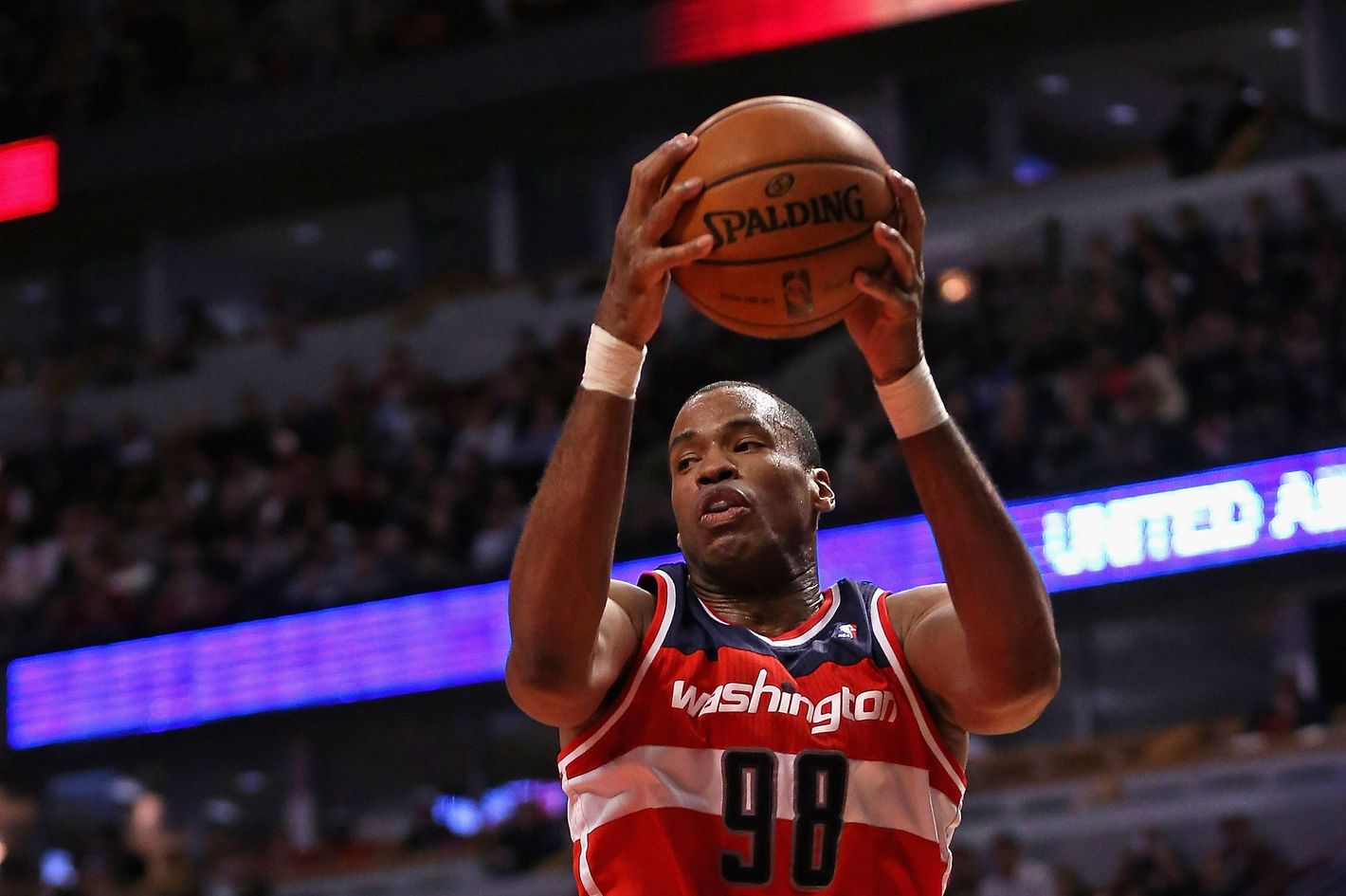 Jason Collins #98 of the Washington Wizards rebounds against the Chicago Bulls at the United Center on April 17, 2013 in Chicago, Illinois. The Bulls defeated the Wizards 95-92.