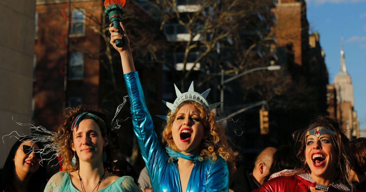 A woman dressed as Statue of Liberty reacts as she takes part during an  International Women's Strike Rally in Washington square park on March 8, 2017 in New York City.