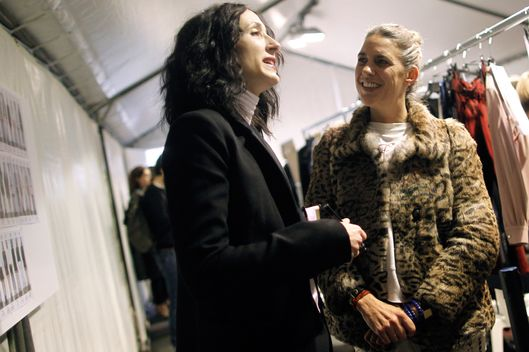French designer Isabel Marant (R) chats backstage prior to the start of the  Fall/Winter 2012-2013 ready-to-wear collection show, on March 2, 2012 in Paris.