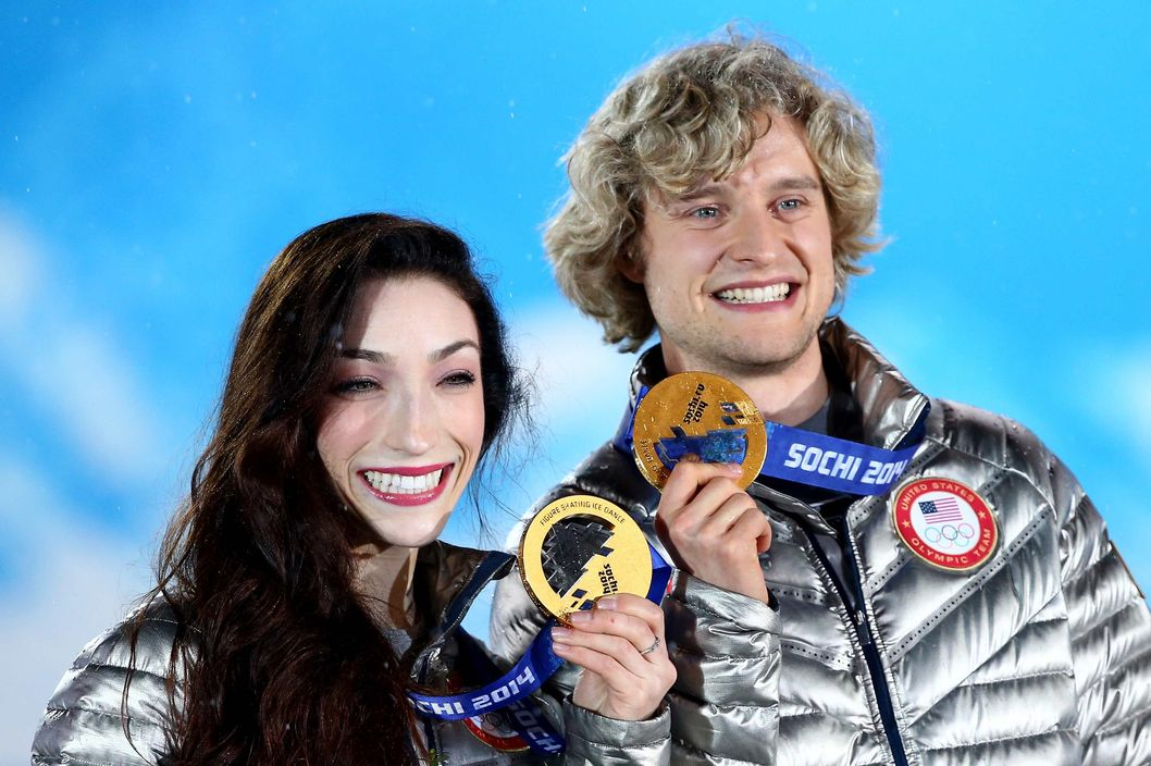 Gold medalists Meryl Davis (L) and Charlie White of the United States celebrate during the medal ceremony for the Figure Skating Ice Danceon day 11 of the Sochi 2014 Winter Olympics at Medals Plaza on February 18, 2014 in Sochi, Russia.  (Photo by Ryan Pierse/Getty Images)