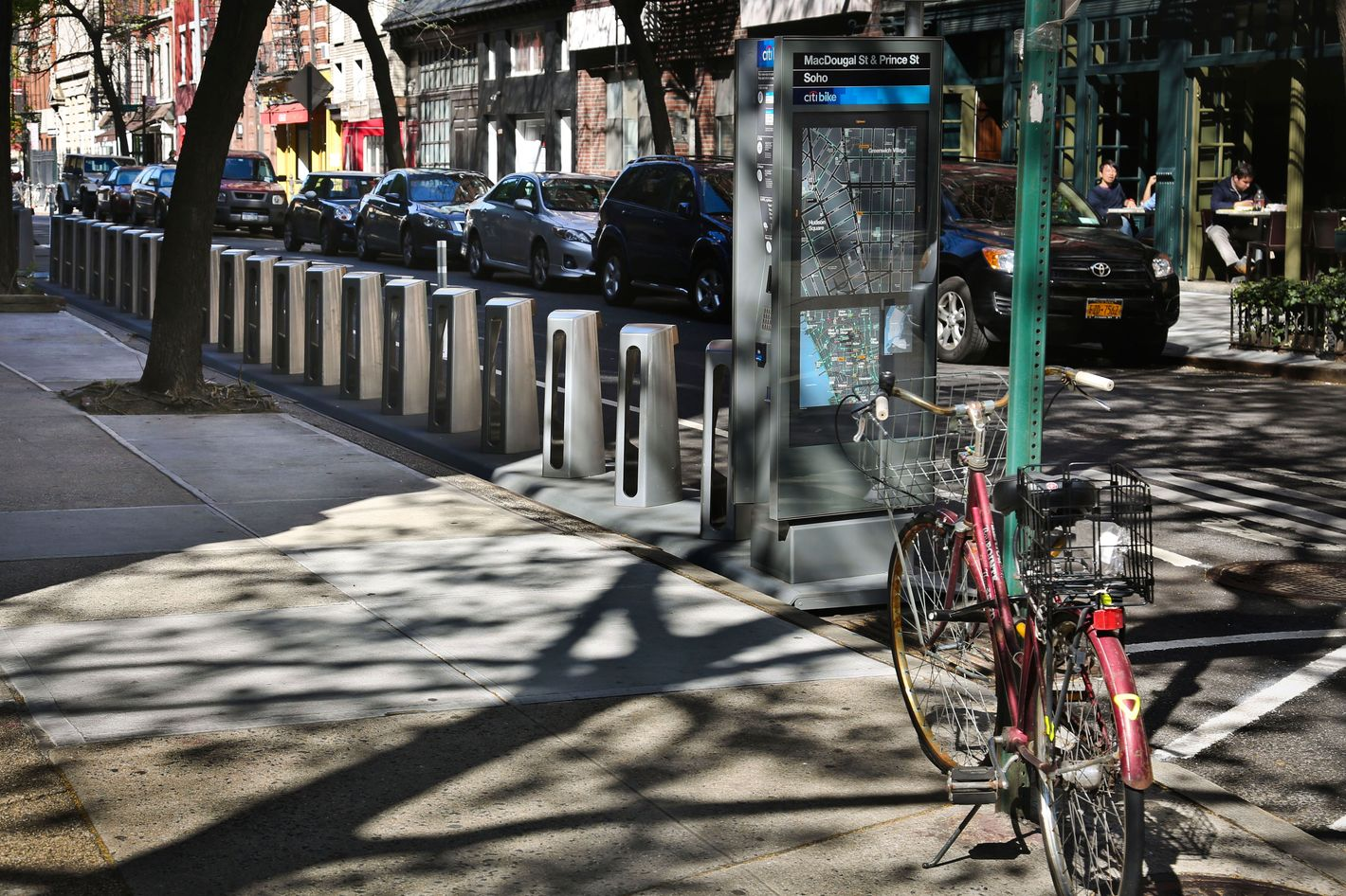 In this Wednesday, May 1, 2013 photo, docks for a new bike share program stand empty on MacDougal Street in New York. This month, New York will join the ranks of Paris, London, Madrid and Washington by enacting its first-ever bike share program.