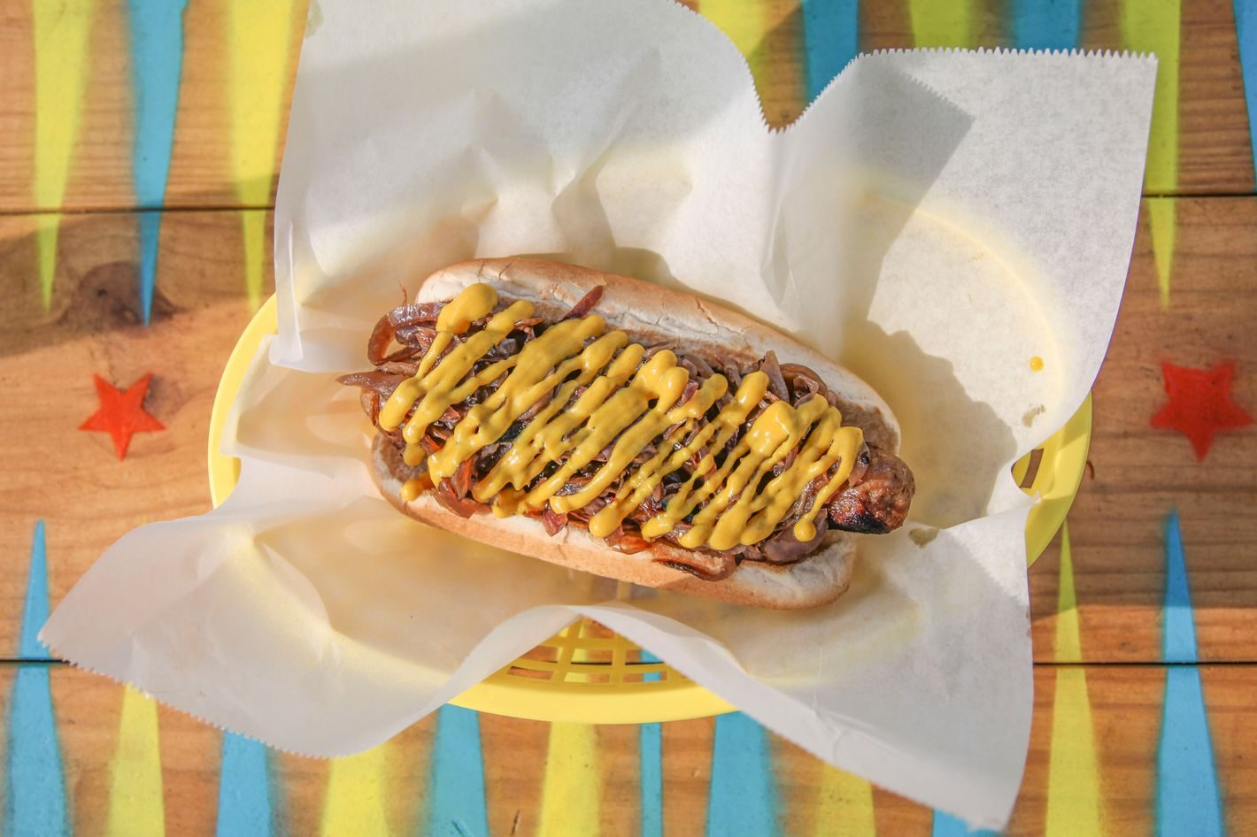 ... bratwurst with mustard and caramelized onions. Photo: Hannah Mattix