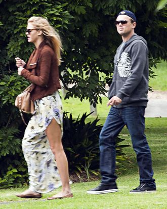 Erin Heatherton & Leonardo DiCaprio, neither looking particularly happy about being photographed.