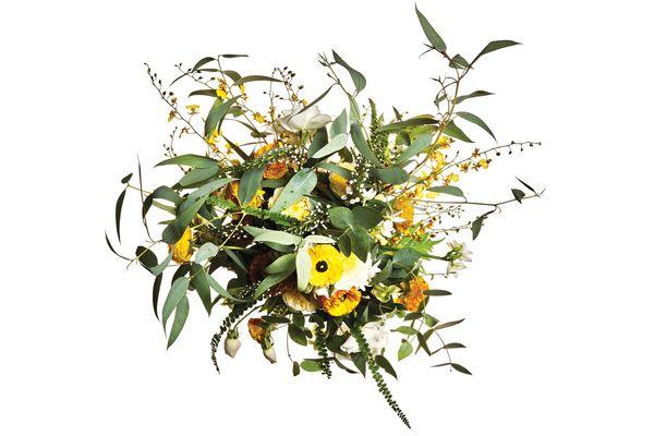 Ranunculus, garden rose, spray rose, paperwhite, hellebore, oncidium orchid, and eucalyptus