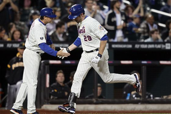 NEW YORK, NY - SEPTEMBER 24: Ike Davis #29 of the New York Mets celebrates a home run with coach Tim Teufel in the fourth inning against the Pittsburgh Pirates at Citi Field on September 24, 2012 in the Flushing neighborhood of the Queens borough of New York City.  (Photo by Alex Trautwig/Getty Images)