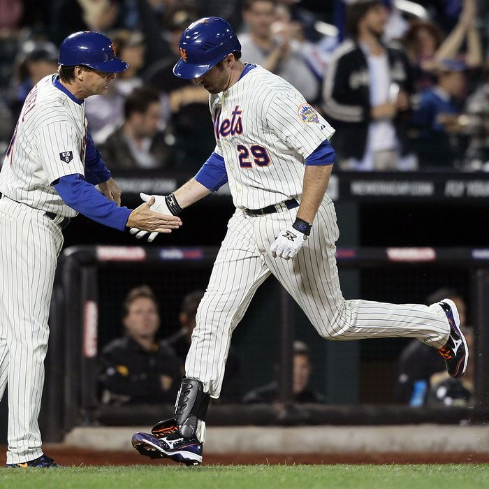 Ike Davis #29 of the New York Mets celebrates a home run with coach Tim Teufel in the fourth inning against the Pittsburgh Pirates at Citi Field on September 24, 2012 in the Flushing neighborhood of the Queens borough of New York City.
