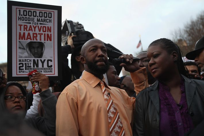"NEW YORK, NY - MARCH 21:  Tracy Martin (L), and Sybrina Fulton, parents of slain teenager Trayvon Martin, address supporters at a Million Hoodies March on March 21, 2012 in New York City. Family members joined hundreds of protesters calling for justice in the killing of Trayvon Martin, 17, who was was pursued and shot on February 26 in Sanford, Florida by ""neighborhood watch"" member George Zimmerman, reportedly because the teenager's hoodie made him look suspicious. Under Florida's ""Stand Your Ground"" law, Zimmerman has not been charged with a crime in the shooting.  (Photo by John Moore/Getty Images)"