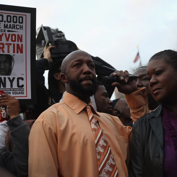 NEW YORK, NY - MARCH 21: Tracy Martin (L), and Sybrina Fulton, parents of slain teenager Trayvon Martin, address supporters at a Million Hoodies March on March 21, 2012 in New York City. Family members joined hundreds of protesters calling for justice in the killing of Trayvon Martin, 17, who was was pursued and shot on February 26 in Sanford, Florida by