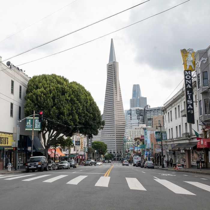 The Transamerica Building stands at the end of an empty Columbus Avenue in San Francisco, California, U.S., on Tuesday, March 17, 2020.