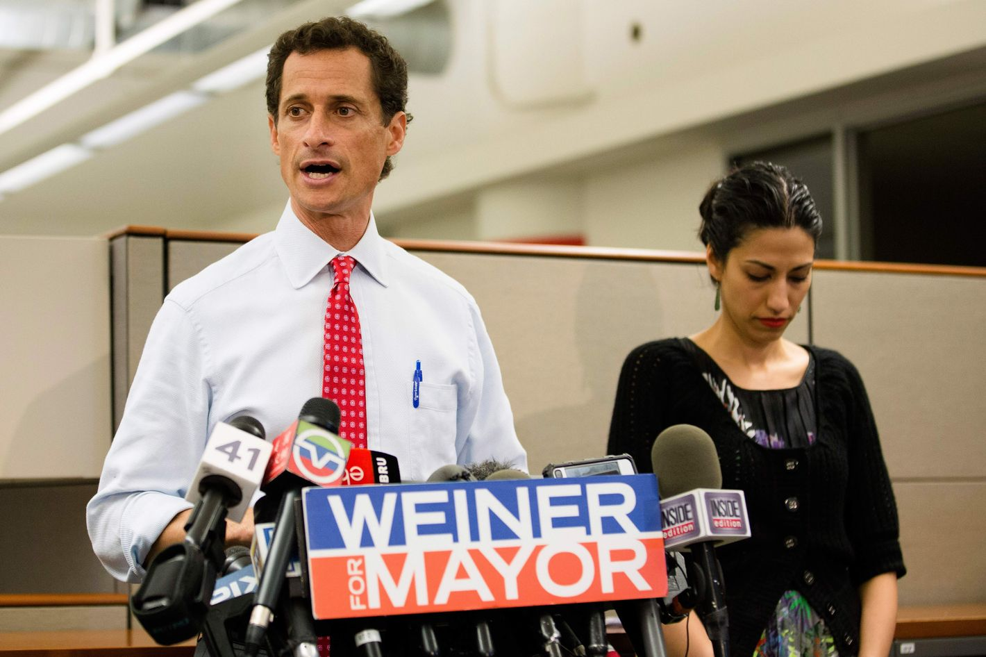 New York mayoral candidate Anthony Weiner speaks during a news conference alongside his wife Huma Abedin at the Gay Men's Health Crisis headquarters, Tuesday, July 23, 2013, in New York.  The former congressman says he's not dropping out of the New York City mayoral race in light of newly revealed explicit online correspondence with a young woman.