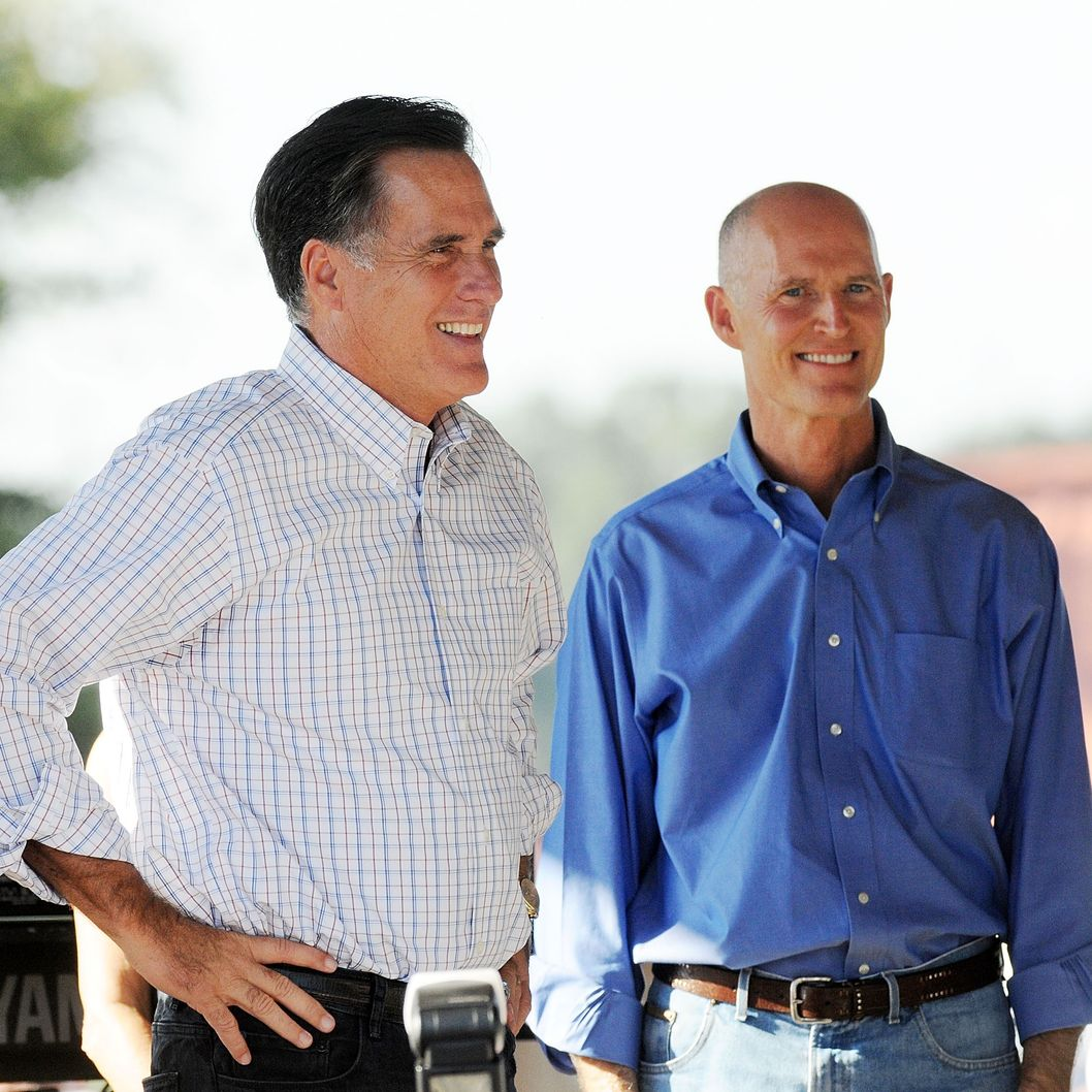 Former Massachusetts Governor Mitt Romney (L) and Rick Scott, Republican gubernatorial candidate for Florida, smile during a rally on October 1, 2010 in The Villages, Florida.