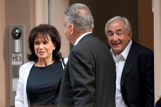Dominique Strauss-Kahn (R) and his wife Ann Sinclair exit their townhouse July 1, 2011 in New York.