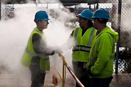 John Shammah, a Con Edison employee, speaks to co-workers while working on a steam pipe on First Avenue on October 31, 2012 in New York City. Residents and businesses across the eastern seaboard are attempting to return to their daily lives and normal operations as clean-up from Hurricane Sandy continues.