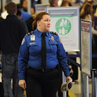 A US Transportation Security Administration (TSA) officer monitors passengers in a security line November 24, 2010 at La Guardia Airport in New York on what is considered the heaviest travel day of the year.