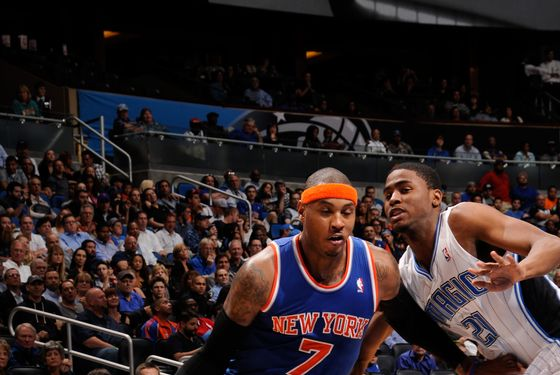 Carmelo Anthony #7 of the New York Knicks drives against Moe Harkless #21 of the Orlando Magic during the game between the New York Knicks and the Orlando Magic on November 13, 2012 at Amway Center in Orlando, Florida.