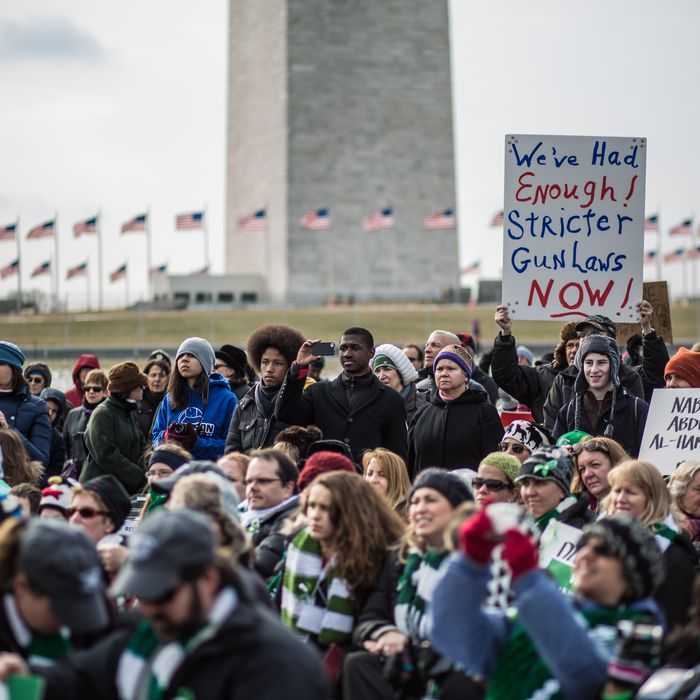 WASHINGTON, DC - JANUARY 26: Advocates of stricter gun control laws gather on the National Mall for a rally following a march through downtown on January 26, 2013 in Washington, DC. The demonstrators included survivors of the shooting at Virginia Tech, Newtown, Connecticut, and others. (Photo by Brendan Hoffman/Getty Images)
