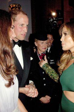 Jennifer Lopez schmoozing with the royal couple.