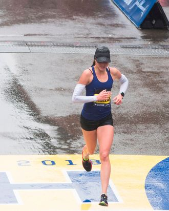 Sarah Sellers crossing the finish line at the Boston Marathon.