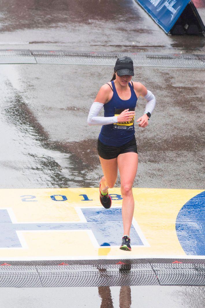 Sarah Sellers crossing the finish line at the Boston Marathon.