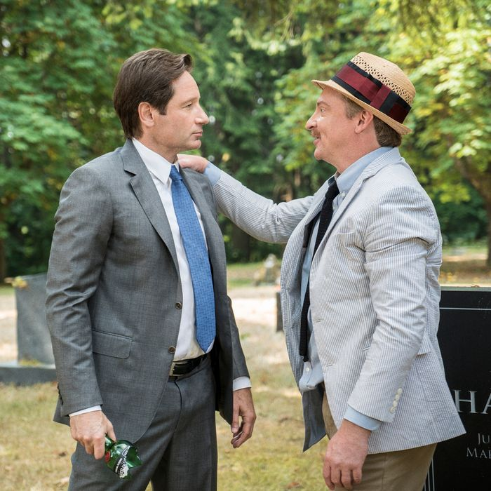 THE X-FILES: David Duchovny and guest star Rhys Darby in the
