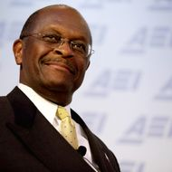 WASHINGTON, DC - OCTOBER 31:  Republican presidential candidate and former Godfather's Pizza chief executive Herman Cain participates in a discussion about his 9-9-9 tax plan at the American Enterprise Institute October 31, 2011 in Washington, DC. POLITICO.com reported Sunday that the National Restaurant Association paid settlements to two female employees who accused Cain of harassment when he was president of the association in the 1990s. With many voters crediting his business experience, Cain is tied with former Massachusetts Governor Mitt Romney at the top of the Des Moines Register's recent survey of likely caucus participants in Iowa.  (Photo by Chip Somodevilla/Getty Images)