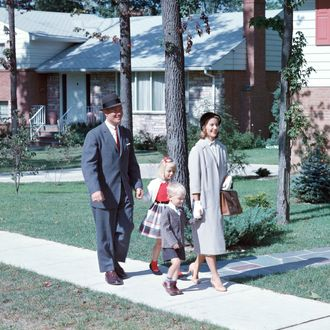 Family walking along suburban street
