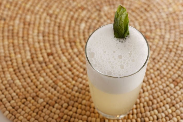 The herbed gin fizz, made with London dry gin, lime, sugar, pear liqueur, sage, and egg whites.