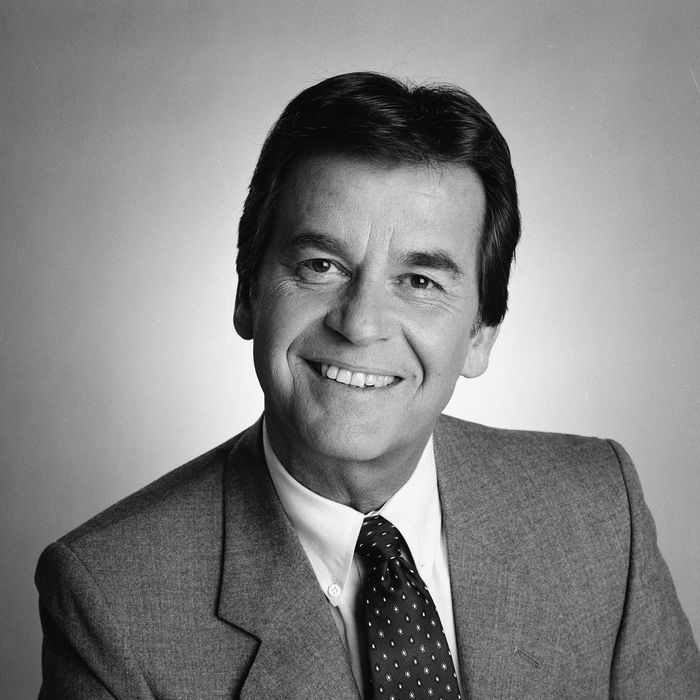 Headshot studio portrait of American television host, producer, and actor Dick Clark, dressed in a blazer and tie, February 25, 1985.