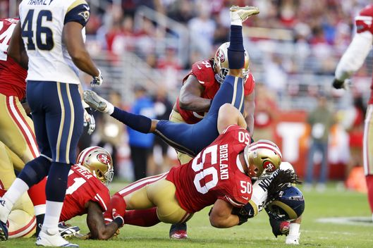 Tre Mason #27 of the St. Louis Rams is tackled by Chris Borland #50 of the San Francisco 49ers during the fourth quarter at Levi's Stadium on November 2, 2014 in Santa Clara, California.  (Photo by Ezra Shaw/Getty Images)