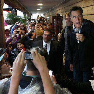 Republican presidential candidate, former Massachusetts Gov. Mitt Romney addresses supporters while appearing with comedian Jeff Foxworthy at the Whistle Stop cafe March 12, 2012 in Mobile, Alabama. Alabama and Mississippi hold their primaries tomorrow.