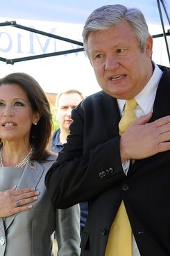"WATERLOO, IA - JUNE 27:  Rep. Michele Bachmann (R-MN) and her husband Marcus Bachmann recite the Pledge of Alligence, prior to her announcing her candidacy for the 2012 Republican presidential nomination at the historic Snowden House June 27, 2011 in Waterloo, Iowa. Bachman officially opened her candidacy in her hometown and was quoted saying ""I seek the presidency not for vanity, but because America is at a crucial moment.""  (Photo by Steve Pope/Getty Images)"