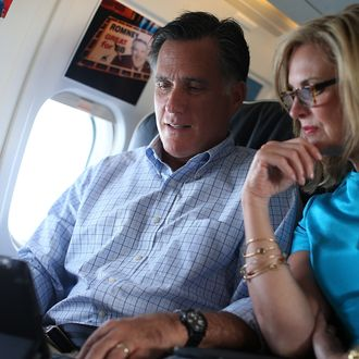 IN FLIGHT, UNITED STATES - SEPTEMBER 01: Republican presidential candidate, former Massachusetts Gov. Mitt Romney (L) and his wife Ann Romney talk on the campaign plane on September 1, 2012 en route to New Hampshire. Mitt Romney is going to his vacation home in New Hampshire for a few days off following the Republican National Convention and a few days of campaigning. (Photo by Justin Sullivan/Getty Images)