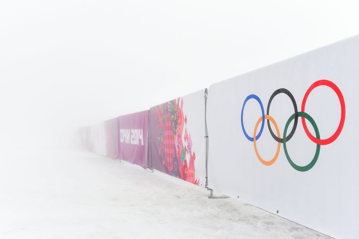 SOCHI, RUSSIA - FEBRUARY 17: A general view of barriers displaying the Olympic rings in fog during day ten of the Sochi 2014 Winter Olympics at Laura Cross-country Ski & Biathlon Center on February 17, 2014 in Sochi, Russia. (Photo by Harry How/Getty Images)