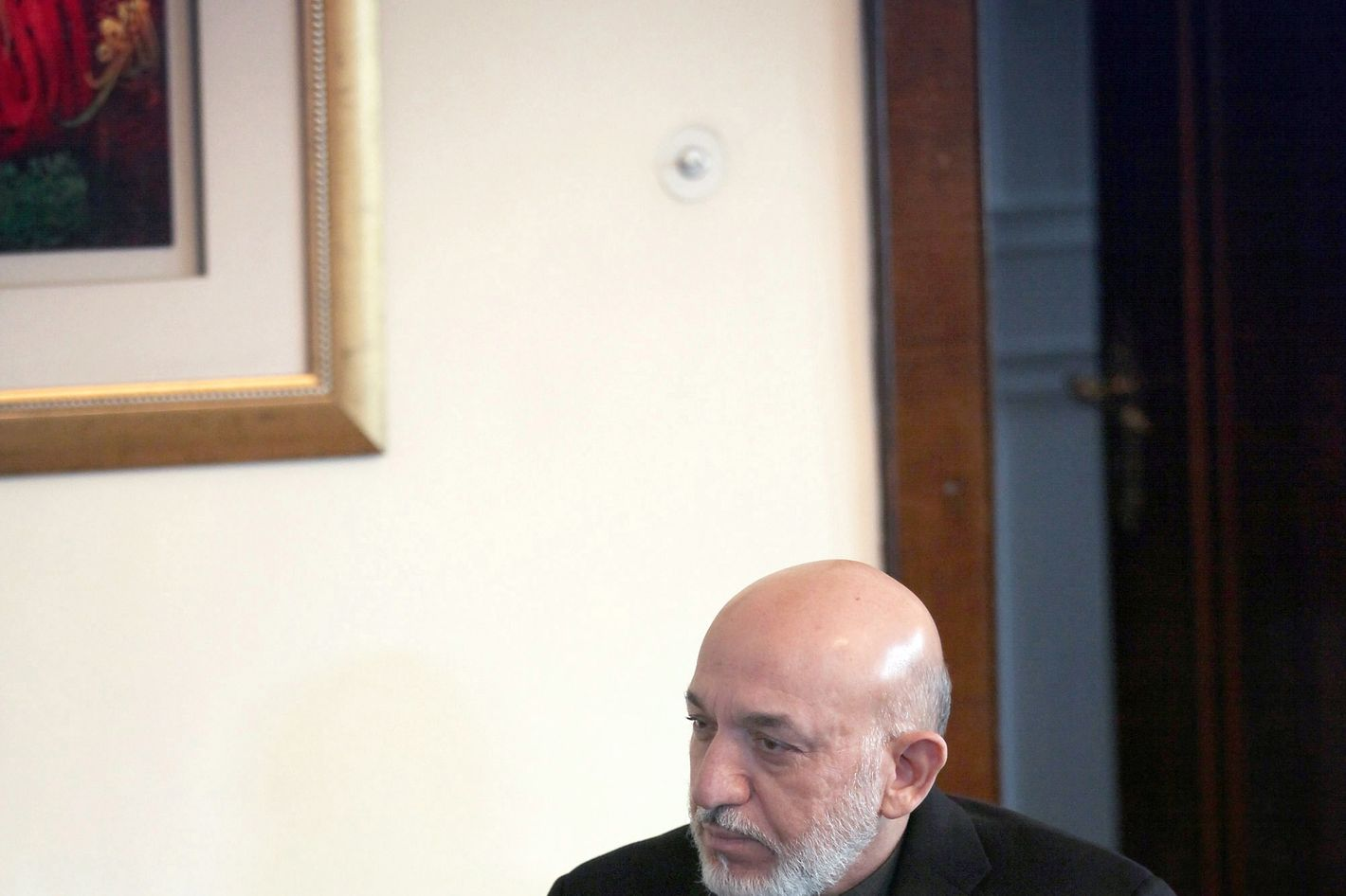 Afghan President Hamid Karzai talks with U.S. Secretary of Defense Leon Panetta at the Presidential Pallace on March 15, 2012 in Kabul, Afghanistan.