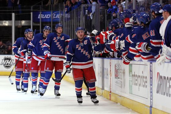 Ryan Callahan #24 of the New York Rangers celebrates with teammates on the bench after he scored a first period goal against the Ottawa Senators in Game One of the Eastern Conference Quarterfinals during the 2012 NHL Stanley Cup Playoffs at Madison Square Garden on April 12, 2012 in New York City.