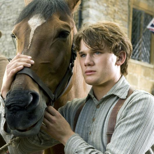 """WAR HORSE""  DM-AC-00047  Albert (Jeremy Irvine) and his horse Joey are featured in this scene from DreamWorks Pictures' ""War Horse"", director Steven Spielberg's epic adventure for audiences of all ages, set against a sweeping canvas of rural England and Europe during the First World War.  Ph: Andrew Cooper, SMPSP  ?DreamWorks II Distribution Co., LLC. ?All Rights Reserved."