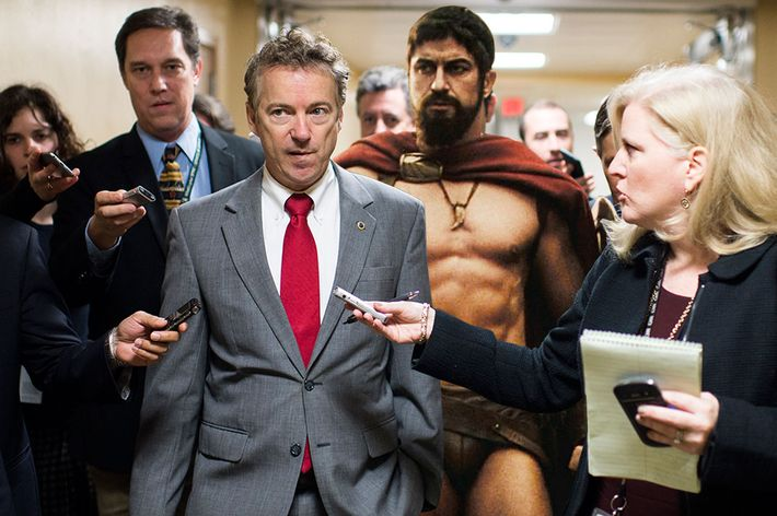 Sen. Rand Paul, R-Ky., speaks with reporters as he arrives for the Senate Republicans' policy lunch in the Capitol on Tuesday, Dec. 16, 2014. (Photo By Bill Clark/CQ Roll Call) (CQ Roll Call via AP Images)