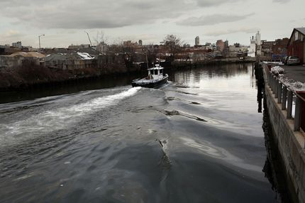 A boat navigates down the polluted Gowanus Canal on March 2, 2010 in the Brooklyn borough of New York. The 140-year-old Brooklyn waterway has just been named as a Superfund site by the federal Environmental Protection Agency. The move to cleanup of the Gowanus, which was opposed by the Bloomberg administration, will cost between $300 million and $500 million and could take 10 to 12 years.NEW YORK - MARCH 02:  A boat navigates down the polluted Gowanus Canal on March 2, 2010 in the Brooklyn borough of New York. The 140-year-old Brooklyn waterway has just been named as a Superfund site by the federal Environmental Protection Agency. The move to cleanup of the Gowanus, which was opposed by the Bloomberg administration, will cost between $300 million and $500 million and could take 10 to 12 years.  (Photo by Spencer Platt/Getty Images)