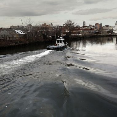A boat navigates down the polluted Gowanus Canal on March 2, 2010 in the Brooklyn borough of New York.
