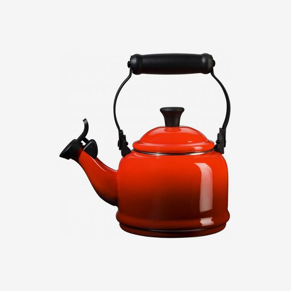 A retro Le Creuset Demi Tea Kettle in bright red with black accents. 33 Things on Sale You'll Actually Want to Buy: From Adidas to Le Creuset - The Strategist