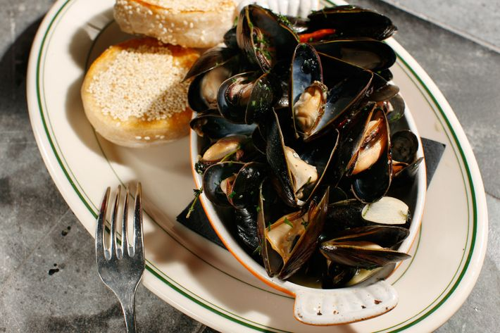 The mussels are served with a bread inspired by Vanessa's Dumpling's shao bing.