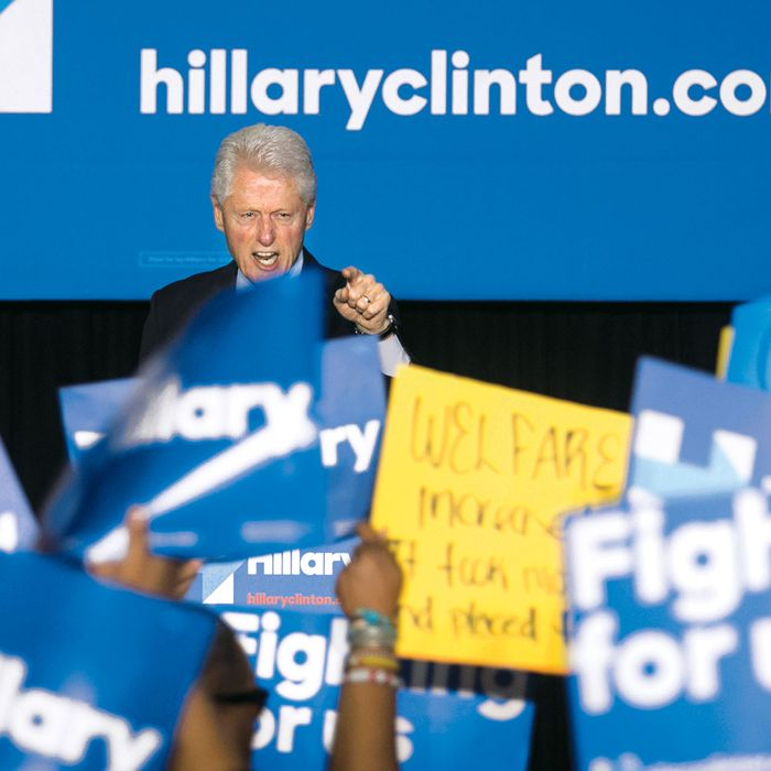 Former President Bill Clinton has a heated exchange with a protester during a rally for Democratic presidential candidate Hillary Clinton, Thursday April 7, 2016, in Philadelphia. Bill Clinton was interrupted by people in the crowd holding signs reading