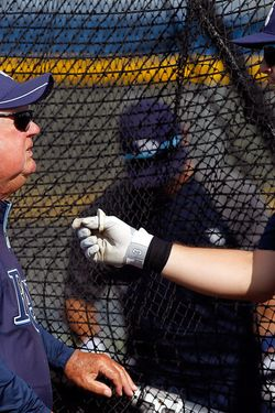 PORT CHARLOTTE, FL - MARCH 23:  Senior baseball advisor Don Zimmer (left) talks with Evan Longoria #3 of the Tampa Bay Rays during batting practice just prior to the start of the Grapefruit League Spring Training Game against the Toronto Blue Jays at the Port Charlotte Sports Complex on March 23, 2012 in Port Charlotte, Florida.  (Photo by J. Meric/Getty Images)