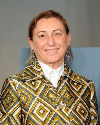 Italian designer Miuccia Prada poses during a press conference announcing the 'Schiaparelli and Prada: Impossible Conversations' exhibition on February 24, 2012 during the Women's fashion week in Milan. The exhibition, curated by Harold Koda and Andrew Bolton and sponsored by the Conde Nast publishing group, running at the New York Metropolitan museum of art from May 10 to August 19, 2012 will feature iconic costumes and approximately 90 designs and 30 accessories by Italian designers Elsa Schiaparelli (1890–1973) from the late 1920s to the early 1950s, and by Miuccia Prada from the late 1980s to the present.