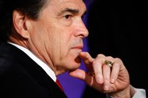 HANOVER, NH - OCTOBER 11:  Republican presidential candidate and incumbent Texas Gov. Rick Perry prepares for a presidential debate hosted by Bloomberg and the Washington Post on October 11, 2011 at Dartmouth College in Hanover, New Hampshire. The event moderated by U.S. television talk show host Charlie Rose and featuring eight Republican candidates, presents the first debate of the 2012 political season focused solely on the economy.  (Photo by Scott Eells-Pool/Getty Images)