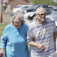 Senior Couple Walking Together on Sunny Day