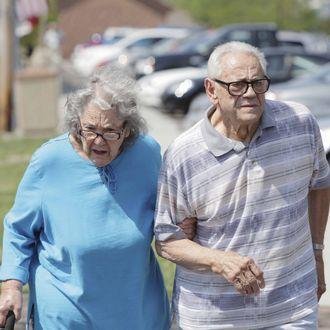 Senior Couple Walking Together on Sunny Day